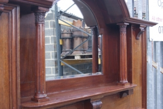 mahogany fire surround with over-mantle mirror