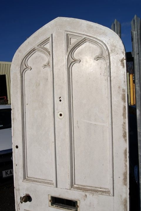 Arched Victorian door with sandstone arched top