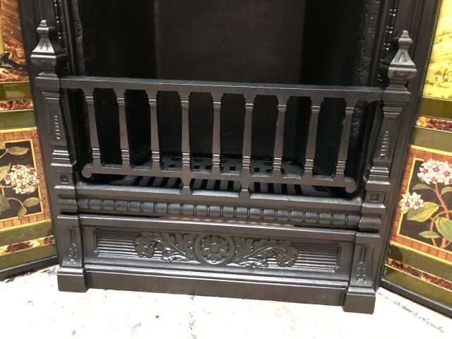 Cast iron tiled combination grate